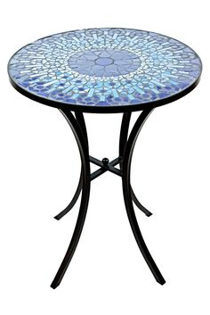 This ceramic tile, mosaic design accent table adds elegance to any indoor or outdoor decor. The intricate tile pattern is handcrafted for an impeccable finish and the durable powder-coated steel provi
