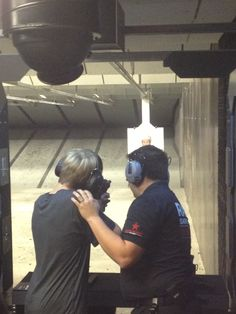 An #MGA Range Safety Officer leading a guest through their live fire experience. #MGA #OrlandoAttraction