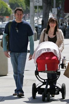 Alyson Hannigan goes shopping for baby clothes with child and husband in Los Angeles