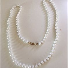 """Monet White Beaded Necklace White beaded necklace knotted between each bead. Stamped Monet. 26"""" long. Excellent condition. No trades Monet Jewelry Necklaces"""