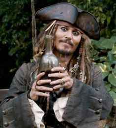 °~ Captain Jack Sparrow and another bottle of rum Captain Jack Sparrow, On Stranger Tides, Rum Bottle, Here's Johnny, Jonny Deep, Pirate Life, Film Quotes, Pirates Of The Caribbean, Disney And Dreamworks