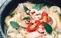 """Chef and author David Tanis insists on making broth for this restorative and iconic soup (pho ga) from scratch and warns against overcooking the noodles: """"They should be pretty firm and snappy, not flabby."""""""
