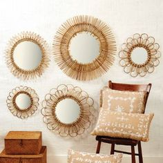 The Set of 5 Rattan Mirrors reflects decorative pieces that can be arranged in a myrid of ways to add the warmth and style needed to any room. Please note that imperfections in these wall accessories are natural characteristics of the material. $400