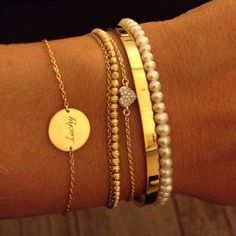 Creating a layered bracelet effect w various thin gold bracelets.