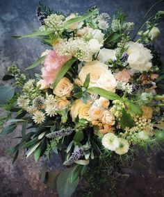Palest peach loose romantic summer bouquet. Roses, Jana spray roses, Asclepius, Nigella, lisianthus, acacia mimosa