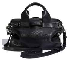 3.1 PHILLIP LIM     LARK SMALL DUFFLE BLACK LEATHER HANDBAG    Richly textured, unstructured lark small duffle in black from 3.1 Phillip Lim cut from glazed calfskin leather.    This leather structured duffle handbag features double rolled top handles, a removable adjustable shoulder strap    wit...