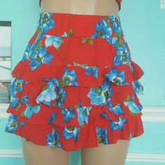 Beautiful ruffle Floral Skirt Super cute and chic ! New with tags.  Size small . Abercrombie & Fitch Skirts Mini