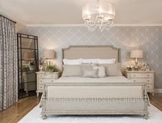 Distressed painted wood, elegant wallpaper and gray neutrals set the tone for this romantic bedroom.