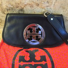 Tory Burch Black Purse Tory Burch Black and Silver Purse. Straps are 27 inches long from shoulder down. Straps can be taken off to use as a clutch as well. Has light scratching on logo (which I took pictures of) the inside is beige and has some make up stains. Comes with dustbag. 11 inches length, 7 inch height. Tory Burch Bags