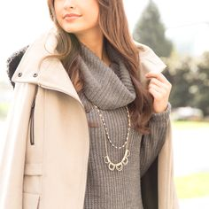 Bundle up in neutral layers and accessorize with long necklaces to stay stylish even when it's cold outside.