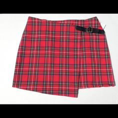 bOgORed Plaid Skirt Super awesome red plaid skirt looks even cooler than the navy blue one. Pair this skirt with some tights and a fuzzy white cropped sweater. *ALSO Available in navy blue in LARGE only* [Not Brandy Melville just for views] •No Trades• Brandy Melville Skirts