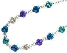 Chunky Mobius Knot Ball Necklace - free tutorial online. Choose your favourite colours in saw cut anodised aluminium jump rings to make this easy chain maille necklace. Design by Sarah Austin of Beadsisters