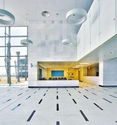 lobby, atrium , floor tile, wall panels, lighting