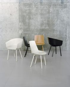 Collection of Chairs –oak or walnut veneered and lacquered plywood Named after the great magician Harry Houdini, Houdini's slender silhouette is comprised of thin plywood shells, magically held in place without screws or nails. The result of a sophisticated combination of craft and industrial production, the complex shapes of the invisible frame elements are milled …