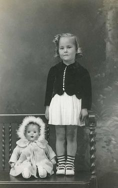 Little girl in cute outfit with her doll