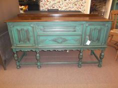 $450 - Rustic chic long legged buffet with 2 drawers and 2 cabinets for storage - painted turquoise, distressed and antiqued with a wood tone top. ***** In Booth H12 at Main Street Antique Mall 7260 E Main St (east of Power RD on MAIN STREET) Mesa Az 85207 **** Open 7 days a week 10:00AM-5:30PM **** Call for more information 480 924 1122 **** We Accept cash, debit, VISA, Mastercard, Discover or American Express