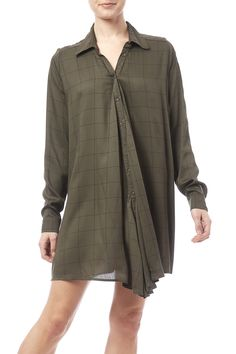 This olive and black windowpane plaid shirtdress features extra fabric in the front for an optional side-drape look. Buttons down the front back pleat long sleeves and a cool drapey silhouette. Ludlow Plaid Shirtdress by Knot Sisters. Clothing - Dresses - Long Sleeve Clothing - Dresses - Casual Clothing - Dresses - Printed Denver Colorado
