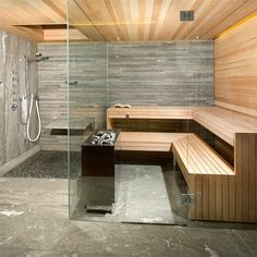 Cozy Sauna Shower Combo Comforting Your Bathe Activities: Beautiful Design Of Sauna Shower Combo With Tile Flooring And Pebble Stone Tile Also Wood Tile With Shower Bench And Rain Shower Plus Glass Door. Kieselsteine im Duschbereich der Sauna.