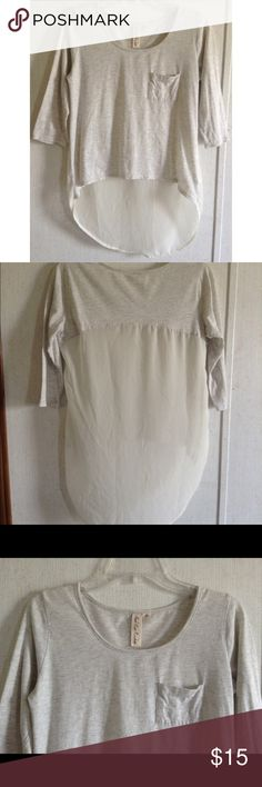 Next Era Couture Chiffon Back Top Great condition. Little wash wear on the gray fabric. One side appears longer than the other because of the side tag. Super cute Next Era Couture top. Gray t-shirt like fabric front with silver sparkles. Most of the back is sheer cream chiffon fabric. High-low style, longer in the back than the front. Pocket on the front. 3/4 length sleeves. Size medium. Next Era Couture Tops Blouses