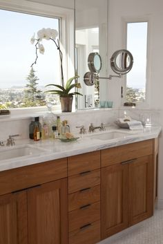 Consider a window instead of a mirror over the bathroom sink. Aids in accurate makeup application...you're so vain. :)