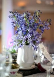 Pretty lavender flowers filling a tea pot for perfect wedding decor.  Florals by Birdie.  Photo by Candi Coffman Photography. #wedding #centerpiece #purple #teapot
