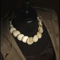 Circular horn statement necklace in cream Beautiful cream colored horn necklace, light weight, adds a great classic + modern look to your wardrobe. Links are made of graduating 1 inch polished horn. Necklace is about 17 inches in length. Ships gift wrapped free of charge. Please feel free to contact me with additional questions. If your looking for seller history I can refer you to my etsy shop so you can see that I have a 100% feedback rating with over 215 comments. infrared studio Jewelry…