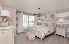 Striped gray walls and pink decor are the perfect match in this beautifully designed girls bedroom. | Pulte Homes #teengirlbedroomideasgrey