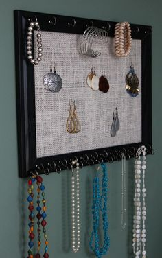 I ACTUALLY did a project that was inspired by pinterest!  Super easy and cheap burlap jewelry organizer.  Love it!  Total cost = less than 5 bucks.