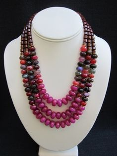 """ANNABEL    ~ 10mm Faceted Fuchsia Jade Rondelles  ~ 9mm Faceted Agate Rondelles  ~ 7mm Red Jasper Barrles  ~ Gold Heishi Accents    21 1/2"""" Length {Longest Strand}  Gold Multi Strand Closure    $298.00"""