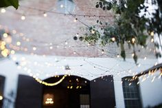 love lighting like this outside for a reception.