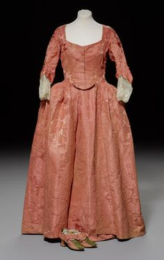 An 18th century two toned salmon pink damask Robe, circa 1775.