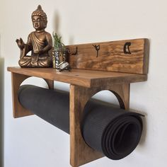 I love making custom orders. It turned out fantastic with black vinyl yoga silhouettes. Wall mountable, hand stained and customized. The perfect #yogi gifts. Large shelf for your #yoga accessories and an all wood yoga mat holder by #YogaWares. #yogini #yo