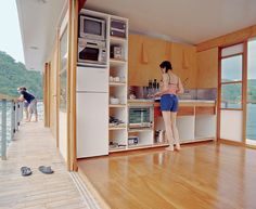 Arkiboat: Cozy House Boat cool design even for land dwelling. turn outside side porches into bright hallways