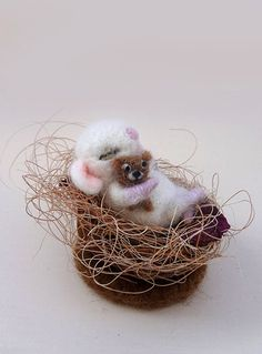 This cute baby mouse was hand made of wool using needle felt techniques. It sleeps in his little cot of a nutshell,filled with fiber of yucca