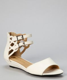 Strut in style in these wonderful wedges. A luxe design, woven straps and flirty peep-toe make for a posh pair.