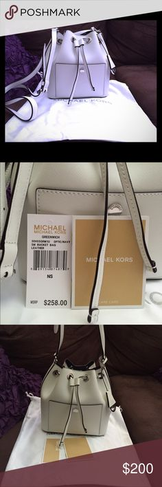 """GREENWICH SMALL BUCKET BAG GREENWICH SMALL BUCKET BAG. Optic white. Saffiano leather. Silver Tone Hardware  -21""""-24"""" Adjustable Strap  -Interior: One Open Pocket -Magnetic Snap Fastening  BRAND NEW, never used Michael Kors Bags Crossbody Bags"""