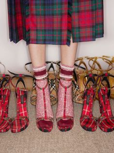 A pair of sandals worked in contrasting wool tartans – reflecting the varied clans and tribes of the British Isles. The style is kept feminine with slender T-bar straps and a high cone heel.