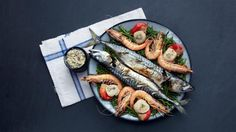 In Norway, celebrations for the longest day culminate in a leisurely smörgåsbord. Mackerel is always a highlight in Scandinavia at this time of year – like herring, it's plentiful and a wallet-friendly addition to your smörgåsbord. Plump scallops and prawns with their shells on complete the platter of grilled seafood, but use whatever you can get hold of. For the full recipe and step-by-step guide visit: http://www.ft.com/cms/s/0/95a07f98-ba6e-11e1-aa8d-00144feabdc0.html