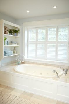 Bathroom with beige stone tile & aqua walls -- designed by Amy Darooge of Villa Decor -- photographed by Ashley Avila