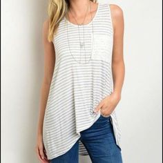 """Hi Low Butter Soft Gray & Ivory Striped Lace Tank Hi Low Striped heather gray and ivory sleeveless tunic/tank with lace pocket and back cutout. Loose fit Butter soft stretchy poly spandex cotton blend. NEW Front length from collar to hem 25"""" Back length from collar to hem 31"""" S chest 34"""" M chest 36"""" L chest 38"""" Tops Tunics"""