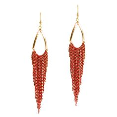When classic meets edgy the Adrienne earring is the result. Open goldtone teardrops feature rows of garnet and gold chain fringe. What a beauty!