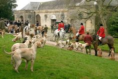 The Hunt Masters with the Hounds at the pre-hunt gathering before one of the last legal fox hunts in England prior to the ban of Feb 18, 2005.