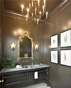 love this! beautiful walls, love painted ceiling too...great look for family bath if we did keep stone floors in there....legs sink, chandelier and sconces..., lacquered bath walls and ceiling..., w/ great art...