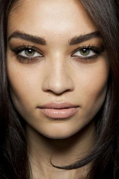 Smudge Espresso shadow on lids and under eyes, add mascara and add a pale lip. Voila.