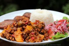 Beef picadillo is a traditional Latin comfort food dish made with ground beef, potatoes, onions, garlic, cumin, bell peppers, white wine, tomato sauce, raisins, olives and capers.