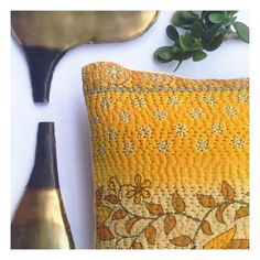Need to brighten up. Here's our gorgeous citrus kantha cushion together with our stunning and unique horizon vases.  #globalliving #zarparliving #kanthathrow #kanthacushions #kantha #citrus #yellow #brass #metalwork #vase #vases #homedecor #interiordecor #interiorinspo #sydney #sydneyliving #northernbeaches
