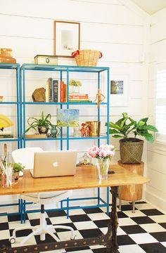black and white floor, blue shelves, stump table