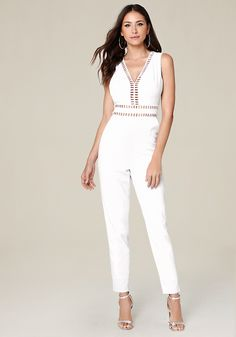 cf1a4c028c68 Shop bebe for  Sleeveless Jumpsuits - White Genevieve Jumpsuit - One and  done. Skin-flaunting jumpsuit with openwork trim and a cutout back.