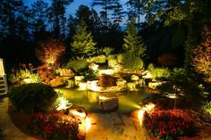Landscape lighting makes a dramatic impact to the garden at night.