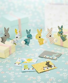 Make Kirsty Neale's quirky rabbits, complete with fabric bows, stacked buttons & pom-poms! Free printable; including nice treat bag printable!!